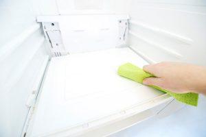 woman-cleaning-fridge_ymmo6i
